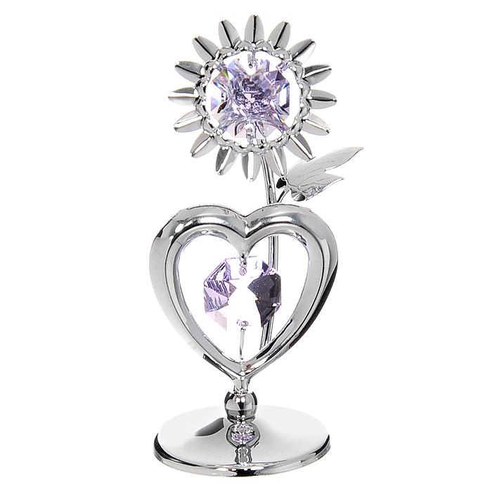Миниатюра Подсолнух с сердцем, цвет: серебристый, 7,5 смU0174-001-CVLМиниатюра Подсолнух с сердцем серебристого цвета, станет необычным аксессуаром для вашего интерьера и создаст незабываемую атмосферу. Кристаллы, украшающие сувенир, носят громкое имя Swarovski. Ограненные, как бриллианты, кристаллы блистают сотнями тысяч различных оттенков. Эта очаровательная вещь послужит отличным подарком близкому человеку, родственнику или другу, а также подарит приятные мгновения и окунет Вас в лучшие воспоминания. Характеристики: Материал: металл, австрийские кристаллы. Высота миниатюры: 7,5 см. Цвет: серебристый. Размер упаковки: 6,5 см х 9 см х 4,5 см. Изготовитель: Китай. Артикул: U0174-001-CVL. Более чем 30 лет назад компания Crystocraft выросла из ведущего производителя в перспективную торговую марку, которая задает тенденцию благодаря безупречному чувству красоты и стиля. Компания создает изящные, качественные, яркие сувениры, декорированные кристаллами Swarovski различных размеров и оттенков, сочетающие в себе превосходное мастерство обработки металлов и самое высокое качество кристаллов. Каждое изделие оформлено в индивидуальной подарочной упаковке, что придает ему завершенный и презентабельный вид.