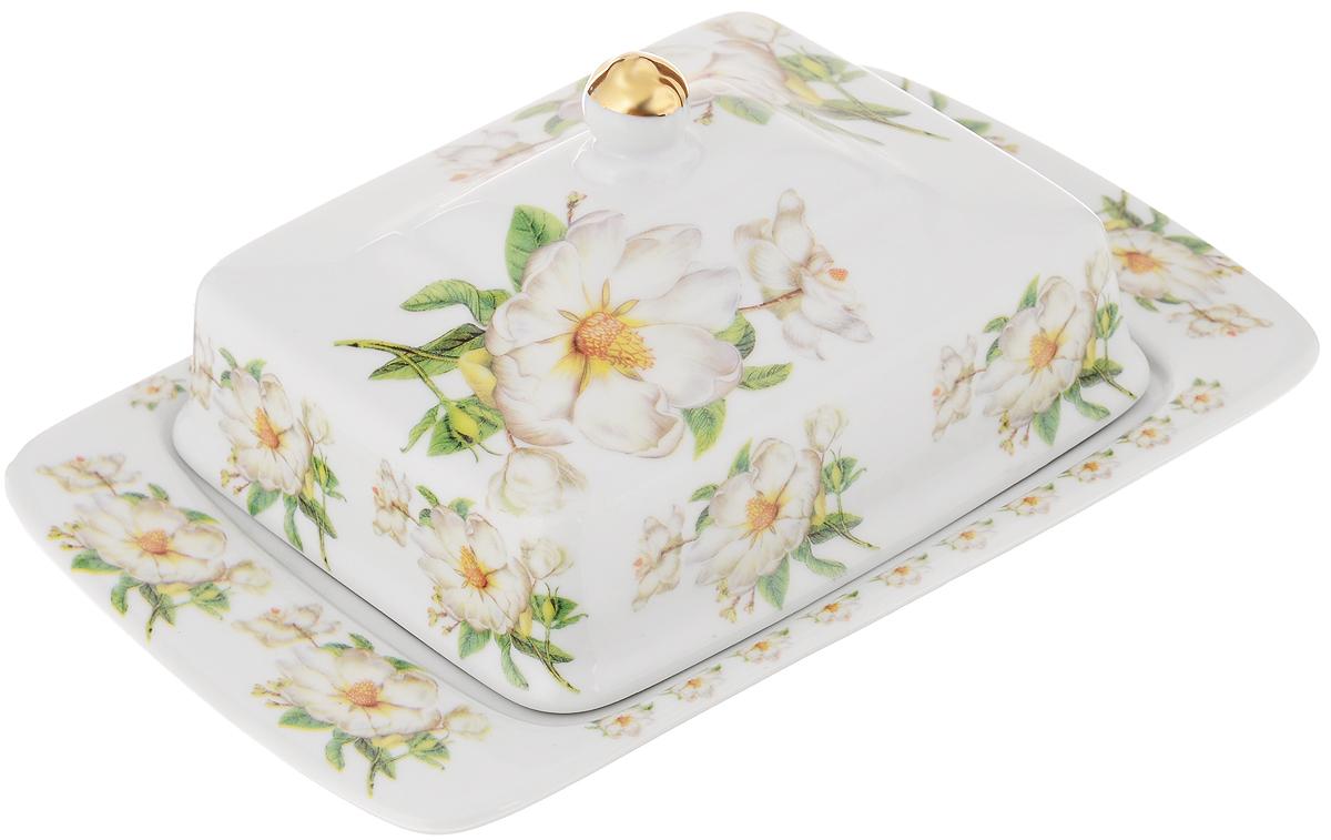 Масленка Loraine Бутон. 2109321093Великолепная масленка Loraine Бутон, выполненная из высококачественной керамики с красивым цветочным рисунком, предназначена для красивой сервировки и хранения масла. Она состоит из подноса и крышки. Масло в ней долго остается свежим, а при хранении в холодильнике не впитывает посторонние запахи. Масленка Loraine Бутон идеально подойдет для сервировки стола и станет отличным подарком к любому празднику. Размер подноса: 20,5 х 13,5 х 2 см. Размер крышки: 14 х 11,5 х 6 см.