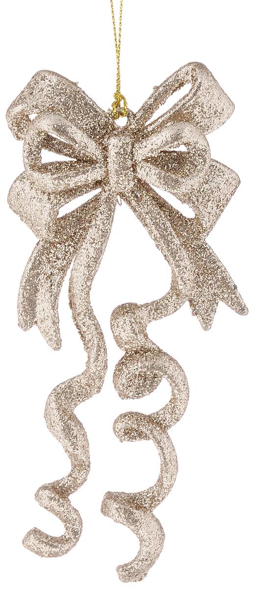 Украшение новогоднее подвесное Magic Time Бант цвета шампань, высота 14 см42101/75112Новогоднее подвесное украшение Magic Time Бант цвета шампань выполнено из полипропилена в виде банта и украшено блестками. С помощью специальной петельки украшение можно повесить в любом понравившемся вам месте. Но, конечно, удачнее всего оно будет смотреться на праздничной елке. Елочная игрушка - символ Нового года. Она несет в себе волшебство и красоту праздника. Создайте в своем доме атмосферу веселья и радости, украшая новогоднюю елку нарядными игрушками, которые будут из года в год накапливать теплоту воспоминаний.
