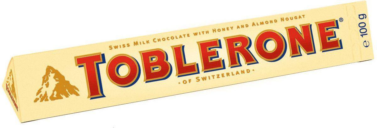 Toblerone шоколад молочный с медово-миндальной нугой, 100 г milka шоколад daim молочный шоколад с кусочками миндальной карамели 100 г