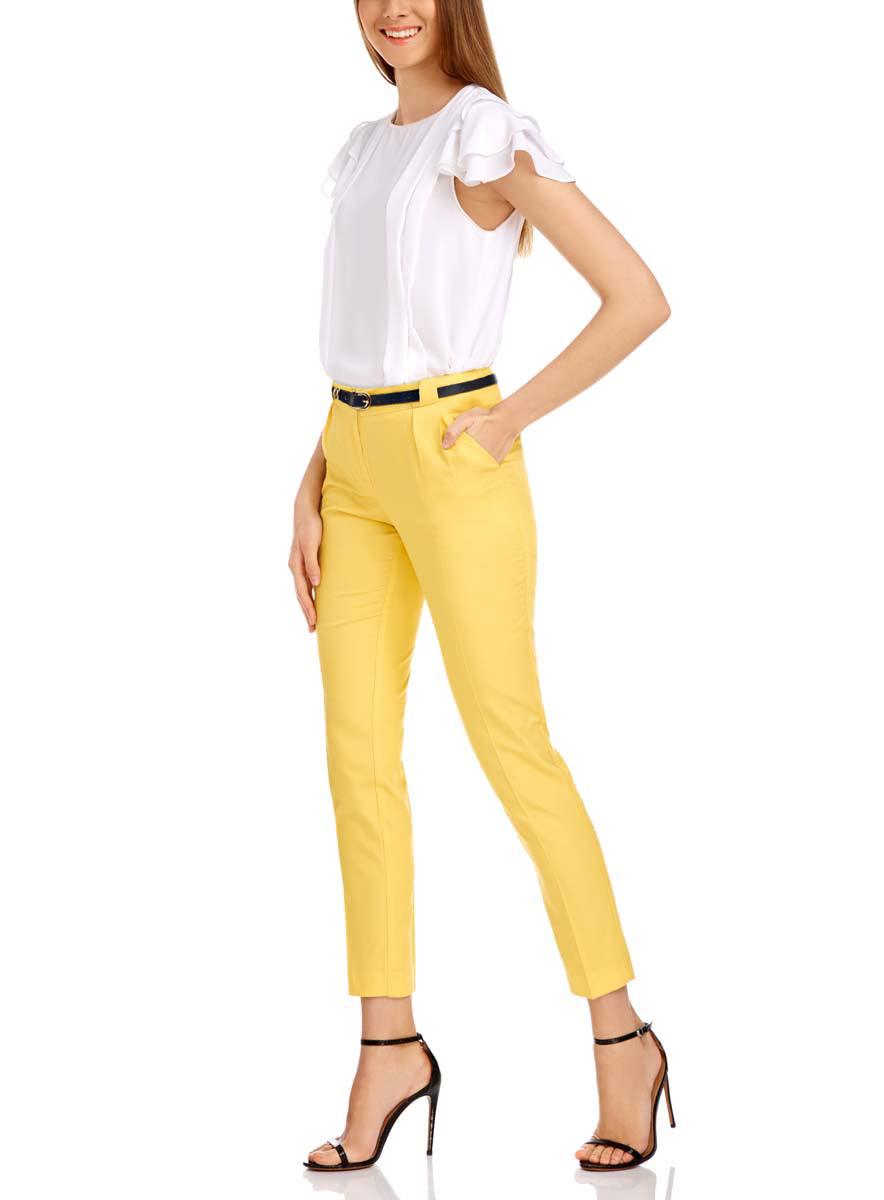 Брюки женские oodji Ultra, цвет: лимонный. 11705007-1/35319/5100N. Размер 34-170 (40-170)11705007-1/35319/5100NСтильные женские брюки oodji выполнены из хлопка и вискозы, комфортны при движении. Модель со стандартной посадкой оформлена сзади декоративными карманами. Спереди брюки имеют два втачных кармана и застегиваются на застежку-молнию и крючок. Также модель оснащена широкими шлевками и тонким контрастным ремнем.