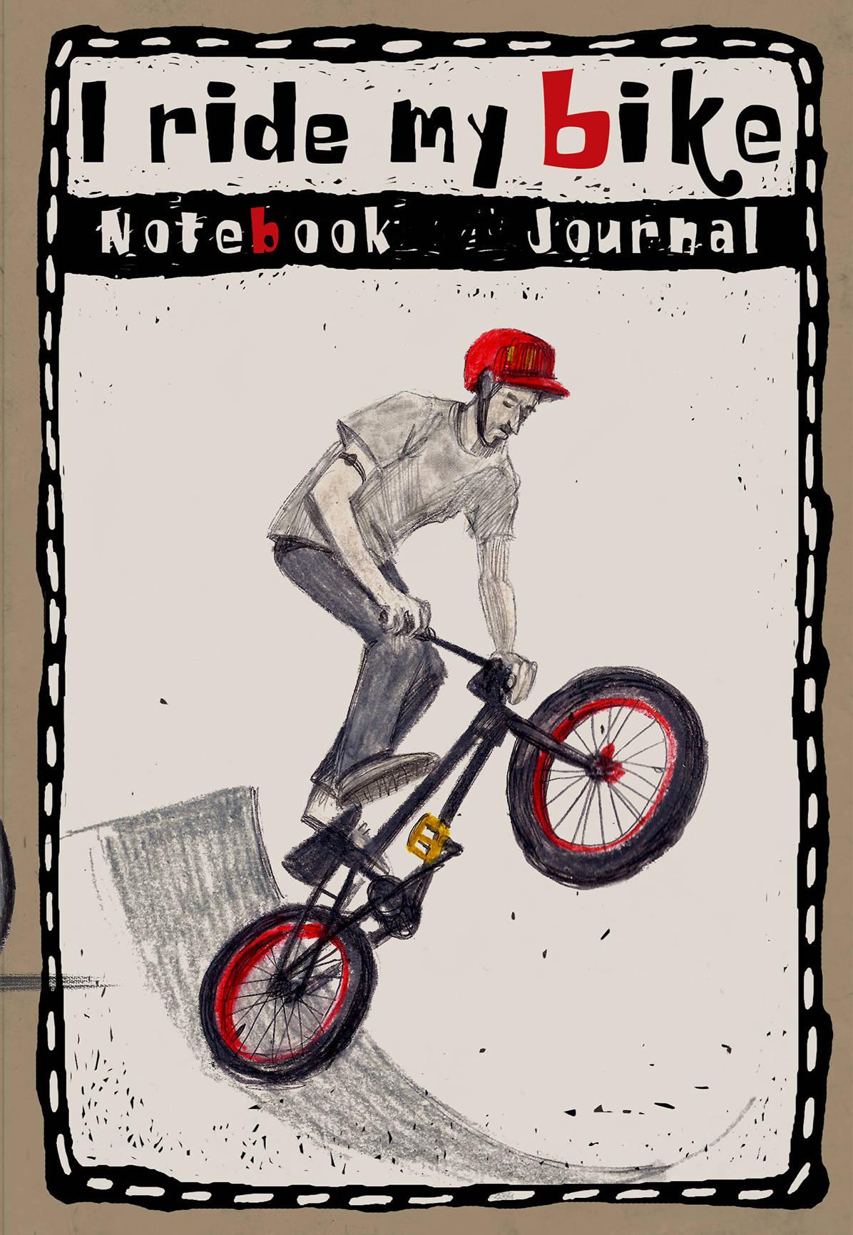 Блокнот. I ride my bike.Мальчик в красном шлеме прыгает на велике