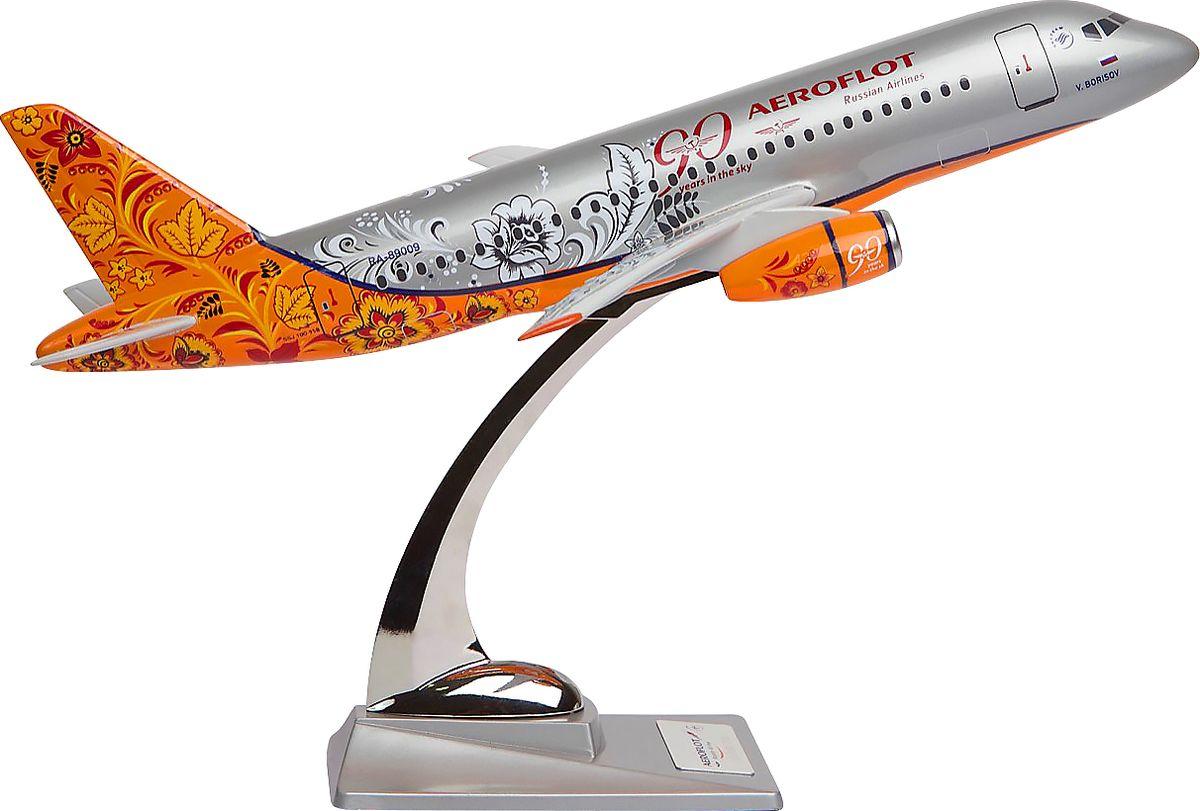 Модель самолета Аэрофлот Sukhoi SuperJet SSJ-100 Хохлома, масштаб 1:1002200001451Модель самолета Аэрофлот Sukhoi SuperJet SSJ-100 в раскраске-ливрее под хохлому, созданной в честь 90-летия Аэрофлота в 2013 году. Модель выполнена из композитной смолы серебристого цвета на металлической стойке. Sukhoi Superjet 100 - ближнемагистральный самолет, первый российский серийный пассажирским авиалайнер с сайдстиком вместо штурвала. Рекомендуем!