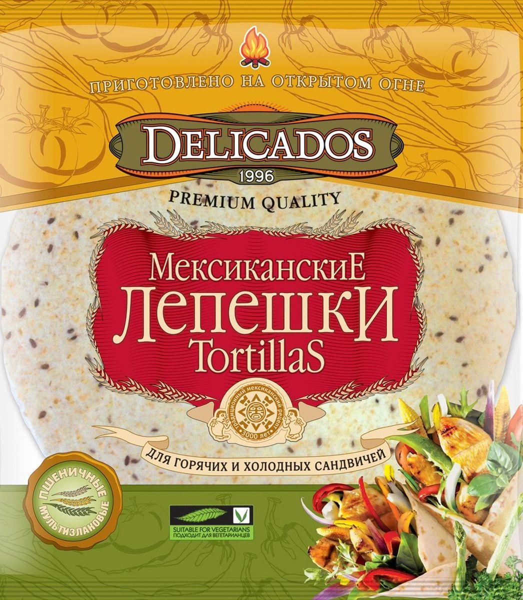 Delicados лепешки мультизлаковые, 400 гбрс003Мексиканская лепешка Тортилья известна всему миру не только как разновидность хлебного продукта или лаваша, но и как символ Мексики. Сложно представить мексиканскую трапезу без тортильи. Ведь этот народ употребляет тортильи около 3000 лет. Еще ацтеки выпекали вкусные лепешки, которые выступали в роли тарелки, ложки и хлеба. Но простота рецептуры и функциональность не утратили своего значения и в современном мире, ведь сейчас в отсутствии времени на приготовление полноценной еды в течение дня, мы привыкли отправлять в желудок все, что попадается под руку. А мультизлаковая тортилья с блеском решает проблему обедов, перекусов и быстрых и полезных бутербродов.