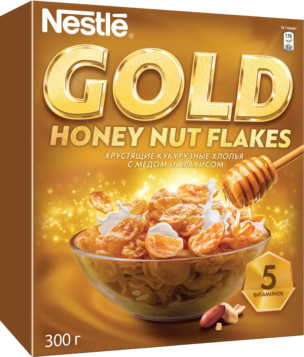 Фото - Nestle Gold Honey Nut Flakes готовый завтрак, 300 г nestle fitness хлопья из цельной пшеницы готовый завтрак 250 г пакет