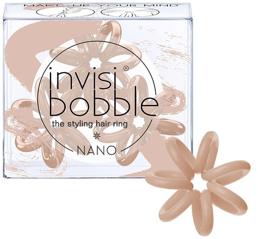 Invisibobble Резинка для волос Nano Make-Up Your Mind3089Резинки-браслеты Invisibobble Nano Make-Up Your Mind телесного оттенка из лимитированной тематической коллекции Invisibobble Beauty. Эксклюзивная упаковка с рисунками тонального крема демонстрирует цвет резиночек, который так сочетактся с кожей! Резинки Invisibobble Nano гораздо меньше в размере, чем Invisibobble Original, тем самым они идеально подходят для создания самых разнообразных причесок, а также детских волос. Резинки подходят для всех типов волос, надежно фиксируют прическу, не оставляют заломы и не вызывают головную боль благодаря неравномерному распределению давления на волосы. Кроме того, они не намокают и не вызывают аллергию при контакте с кожей, поскольку изготовлены из искусственной смолы.