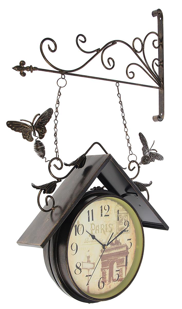 Часы настенные двойные Арка, 42 х 77 см1586551Каждому хозяину периодически приходит мысль обновить свою квартиру, сделать ремонт, перестановку или кардинально поменять внешний вид каждой комнаты. Часы настенные двусторонние Триумфальная арка с крышей, на подвесе, d=23,5 см, черные — привлекательная деталь, которая поможет воплотить вашу интерьерную идею, создать неповторимую атмосферу в вашем доме. Окружите себя приятными мелочами, пусть они радуют глаз и дарят гармонию.Двойные настенные часы, крепление-мет, Круг с крышей черный, на циферблате Арка 42х77см 1586551 Рекомендуем!