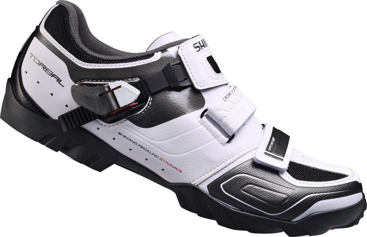 Велотуфли мужские Shimano SH-M089W, цвет: белый. Размер 46SH-M089WТуфли для внедорожных гонок MTB. Универсальность и эффективность на трассе. Верхжесткая устойчивая к растяжению синтетическая кожа и сетка;Cross X-Strap оптимизированы для снижения напряжения верха ступни во время проталкивания педали;сверхнизкопрофильная застежка с микрорегулированием надежно удерживает ногу. Стелька одинарной плотности с повышенной амортизацией принимает форму ноги;противоударная амортизация. Колодка Volume+ для более удобного носка туфли. Торсионная прослойка подошвы обеспечивает естественное текучее движение велосипедиста во время даунхилла;расширенный диапазон регулировки шипов SPD для удовлетворения потребностей гоночного стиля и трэйла;полиамидная композитная прослойка со стекловолокном для передачи энергии;долговечная резиновая подошва;доступна широкая версия.Индикатор жёсткости: 5.