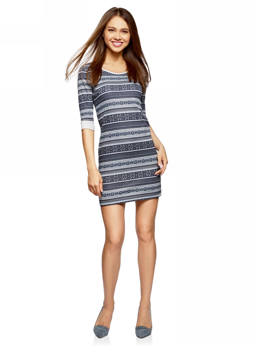 Платье oodji, цвет: темно-синий, серый. 14001064-3/35468/7923J. Размер L (48)14001064-3/35468/7923JЖенское облегающее платье oodji Ultra изготовлено из текстурного мягкого трикотажа, за счет чего способно точно садиться по фигуре. Модель средней длины с круглым воротом и рукавами 3/4 оформлена стильным этническим принтом.