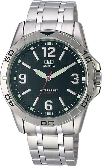 Часы наручные мужские Q & Q, цвет: серебристый. Q576-205 q