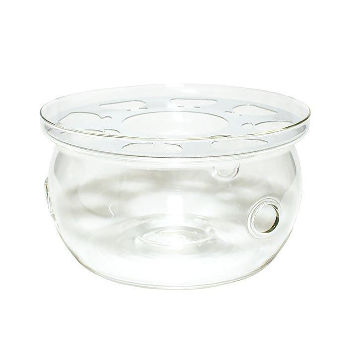 Подставка-подогреватель для чайника ТамаL07001-1Подставка-подогреватель для чайника «Тама» создана для долгих чайных церемоний. Жаропрочное стекло выдержит и мороз в -20, и температуру кипения воды в 100 градусов. Удобная основа позволит чайнику не раскачиваться и не соскальзывать с подставки, а отверстия для циркуляции воздуха обеспечат качественный, равномерный нагрев напитка. Предусмотрено углубление для фиксации свечи. Свеча в комплект не входит. В подставке есть металлический поддон для улучшенной системы поддержания температуры. Можно мыть в посудомоечной машине. Диаметр: 12 см. Высота: 6,5 см. Совместима с заварочными чайниками, имеющих диаметр плоской части дна до 12 см.