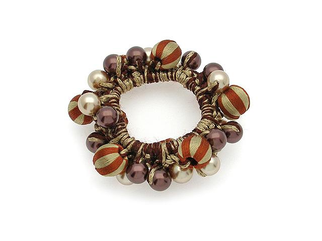 Резинка для волос Magie Accessoires, бусины, цвет: коричневый. 911552911552Резинка для волос с круговой отделкой, бусинами.