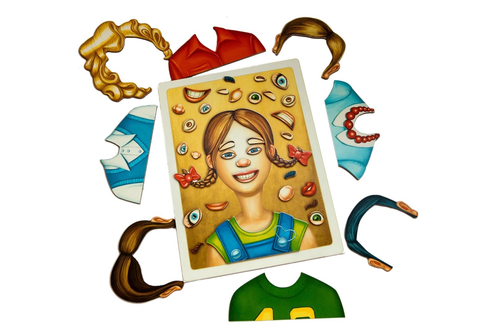 """Деревянный магнитный конструктор «Веселые шаржи» MR.BIGZY 101011653-101011Игра """"Веселые шаржи"""" – это комплект, с помощью которого можно создать множество различных персонажей. Ребенку предлагается поэкспериментировать с овалом лица, дополнив его всеми необходимыми деталями, включая глаза, нос, губы, волосы и одежду. В набор входят следующие детали:1 основа – овал лица в рамке (силуэт, на котором отсутствуют глаза, нос, губы, волосы, одежда);82 дополнительных элемента на магнитах, предназначенных для создания лица (нос, губы, глаза, волосы, борода, брови, очки, усы и одежда).Ребенок сам выбирает любые детали, чтобы «нарисовать» мальчика, девочку, взрослого мужчину или женщину. Он может создавать отдельные персонажи или целые семьи, компанию своих друзей или старшего брата/сестру. Придумывая новых персонажей, малыш получает огромное удовольствие, ведь на начальном этапе развития он только учится создавать что-то новое, и """"Веселые шаржи"""" помогают ему в этом.Игра предназначена для дошкольников и школьников, поэтому она открывает широкие возможности для развития ментальных и физических качеств детей различных возрастов. Для самых маленьких она становится увлекательным путешествием в мир сказки, персонажей для которой они могут придумать и создать самостоятельно, чтобы потом под руководством взрослых или без их помощи выдумать приключения для своих творений. С помощью «Веселых шаржей» малыши от 2 до 5 лет развивают мелкую моторику. Игра стимулирует познавательную активность, расширяет детский кругозор, позволяет научиться проявлять фантаз..."""