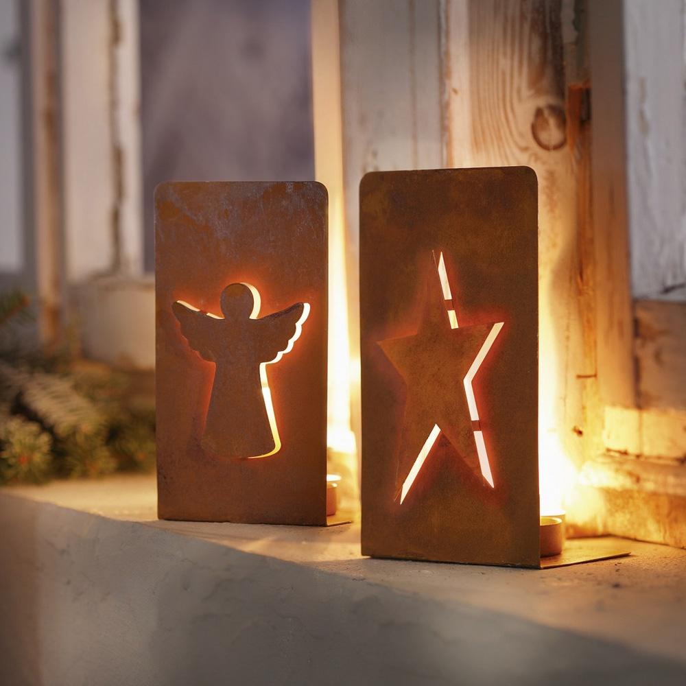 Подсвечник Хит-декор Ангел и Звезда, 2 шт06533Подсвечники выполнены из металла с эффектом ржавчины. Вырезанные в металле фигуры ангела и звезды обеспечивают красивое проникновение света от горящей свечи. Размеры: 10 х 7 х 17 см. Поставляются без свечей. В комплекте 2 штуки.
