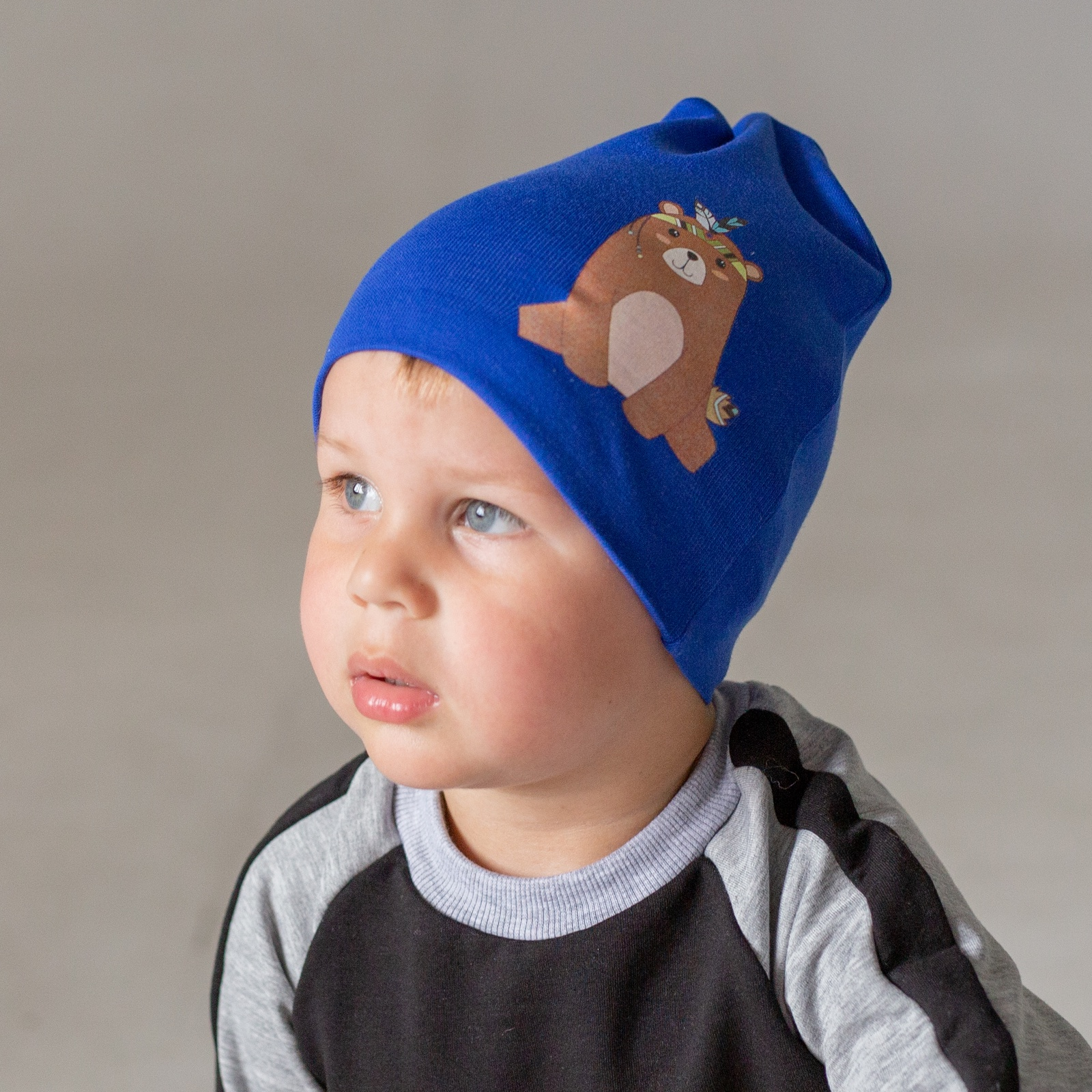 Шапка HOHLOON ШО18-194син 50-54 синий , 50 размерШО18-194син 50-54Шапка двухслойная с аппликацией Мишка-Индеец,цвет синий