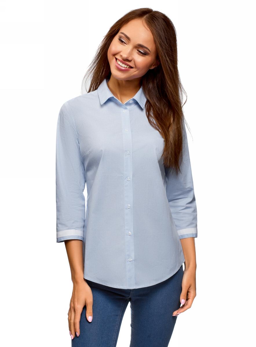 Рубашка женская oodji, цвет: голубой, белый. 13L03003B/43346/7010C. Размер 36 (42-170)13L03003B/43346Оригинальная приталенная рубашка с укороченными рукавами, отложным воротником и застежкой на пуговицы. Особую выразительность рубашке придает контрастная отделка на манжетах и на спинке. Рукава ? акцентируют внимание на запястьях. Хлопок с небольшим добавлением эластичных волокон приятен на ощупь, дышит и комфортен в ношении. Приталенный силуэт красиво подчеркивает фигуру. Клетчатая рубашка с контрастными элементами подойдет для создания стильных комплектов на каждый день. В ней комфортно на работе или учебе, удобно пойти на прогулку или встретиться с друзьями в приятной обстановке. С классическими зауженными брюками и лодочками у вас получится элегантный лук для офиса. Выбрав джинсы, приталенный жакет и кеды, вы легко составите более непринужденный комплект для отдыха. В этой комфортной рубашке вы будете чувствовать себя непринужденно.
