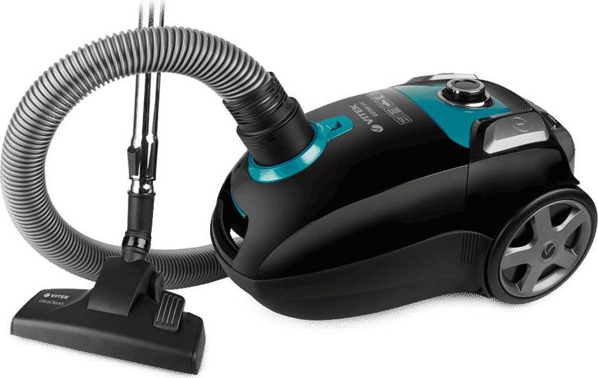 Vitek VT-1898 BK пылесосVT-1898(BK)Пылесос VT-1898 BK станет настоящим подспорьем, если вы планируете генеральную уборку дома. Отличительной особенностью данной модели является широкое отверстие для всасывания воздуха – 45 мм и низкий уровень шума. Устройство работает практически беззвучно: уровень шума составляет всего 69 дБ. Бесшумный пылесос VT-1898 BK от VITEK позволит наводить порядок в помещении с максимальным комфортом для себя и окружающих. Он сохраняет тишину и покой в доме. Такой пылесос оснащен уникальной системой HEPA-фильтров, которая эффективно «борется» за идеальную чистоту в вашем доме: благодаря 5-ступенчатой системе фильтрации пылесос задерживает споры, пепел, пыльцу, бактерии и микроскопические частички пыли размером от 0,3 мкм и больше. Это особенно важно, когда в доме есть дети и люди, страдающие аллергией или астмой: такая тщательная уборка позволяет избежать раздражений органов дыхания. Пылесос VT-1898 BK обеспечен пылесборником емкостью 4,0 л., который не потребует частой замены. Дополнительный тканевый мешок для сбора пыли прилагается в комплекте. Регулировать мощность в зависимости от типа уборки вам поможет удобно расположенный на корпусе пылесоса переключатель. Также в данной модели пылесоса для вашего удобства предусмотрена функция автоматического сматывания шнура. Нажатием соответствующей клавиши шнур втягивается внутрь корпуса пылесоса, что значительно облегчает сматывание шнура после уборки. Работа с пылесосом особенно удобна благодаря стальной телескопической трубке, которую мо...