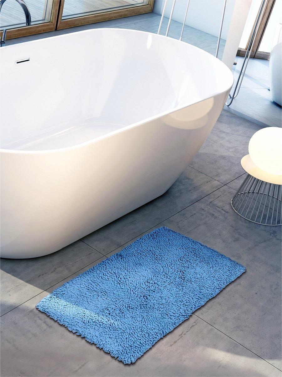 Коврик для ванной DeНАСТИЯ Коврик для ванной длинноворсовый , 60*100 см, голубойM111161Коврик для ванной комнаты изготовлен из 100 Индийского хлопка. Хлопок обладает отличными впитывающими свойствами, быстро сохнет, гигиеничен. Хлопковая нить, оборотной стороны коврика пропитана резиновым противоскользящим составом, который позволяет ему быть устойчивым на любой поверхности. Возможна стирка изделия с применением нейтрального моющего средства.
