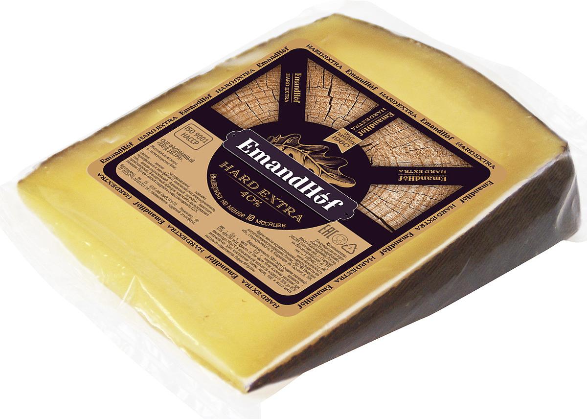 Сыр EmandHof Hard Extra, 40%, 250 гБ0004346По степени зрелости сыр Эмандхоф Хкстра Хард - является самым выдержанным. Срок выдержки составляет не менее 12 месяцев. С характерным хрустом (лактат кальция), что является признаком высшего качества продукта. Твердый сыр - продукт питания имеет в своем составе много витаминов группы В (В1, В2, В6, В9 и В12), он насыщает организм токоферолом, аскорбиновой кислотой, провитамином А и витаминами РР и D. Витамины группы В, которыми богат сыр, способны стимулировать процессы кроветворения, повышать работоспособность, увеличивать выработку энергии и принимать активное участие в течении процессов тканевого дыхания. Потребление сыра поможет улучшить качество ночного отдыха.