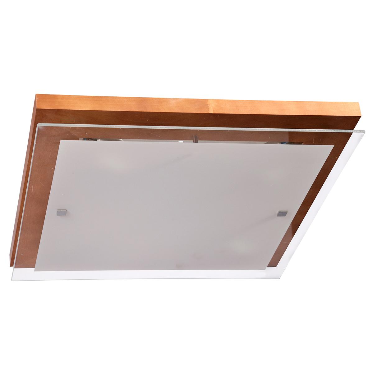 Настенно-потолочный светильник Дубравия Эко106-21-24/2HСветильник настенно-потолочный Эко 4xE27x60Вт Дубравия 106-41-24/3H Элегантная модель этого светильника, который выпускается под брендом Дубравия, относится к серии изделий – Эко. Современный стиль светильника идеально подойдет для гостиной, но также отлично будет смотреться и в других комнатах квартиры и дома. Настенно-потолочный способ крепления позволяет использовать Светильник настенно-потолочный Эко 4xE27x60Вт Дубравия 106-41-24/3H как на стене, так и на потолке, значительно разнообразив варианты декора комнат с помощью этой модели. Основные характеристики плафона: форма плафона – прямоугольный основной цвет плафона – белый материал плафона – стекло поверхность плафона – матовая Позволяют легко вписать эту модель светильника в любой дизайн квартиры или дома. При производстве этой модели светильника используется дерево в качестве материала для арматуры, которая окрашена в цвет – венге. Лампочки с цоколем E27 и используемой мощностью – 4x60Вт рассчитаны на максимальную площадь освещения – 12-20 кв.м. Производитель светильников под брендом Дубравия гарантирует неизменное качество продукции и поддержку высокого уровня сервиса для своих потребителей.