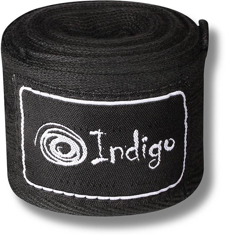 Боксерский бинт Indigo, 1115, черный, 4 м1115Бинты для боксеров просто необходимы, так как они защищают кисти рук от ушибов, вывихов и растяжений. Руки обязательно бинтуют под боксёрские перчатки, чтобы бинты впитывали влагу, оставляя перчатки сухими и продлевая их срок службы. Боксёрские бинты INDIGO 1115 выполнены из чистого хлопка с добавлением нейлона. Крепление на липучке. Эластичный материал обеспечивает максимальную фиксацию.