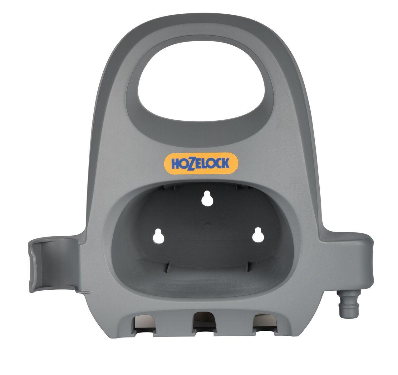 """Катушка для шланга Hozelock 2362 держатель для шланга, серый2362 3600Держатель HoZelock 2362 для шланга позволяет хранить шланг до 30 м диаметра 3/4"""" (19 мм). Шланг в комплект не входит, позволяя использовать собственный шланг или добавить шланг из каталога HoZelock. Отличное решение для удобного хранения шланга, коннекторов и наконечников. Изготовлен из высококачественного пластика. Держатель крепится к стене шурупами, что позволяет удобно наматывать на него шланг, а коннекторы и наконечники с охватываемым соединением """"папа"""" надежно вешаются в отверстиях держателя снизу. После окончания полива намотайте шланг, поместите один конец шланга с охватывающим коннектором """"мама"""" в специальное углубление с одной стороны Держателя, а другой конец с коннектором """"папа"""" легко крепится с другой стороны. Шланг будет компактно храниться на настенном Держателе, который обеспечивает легкий доступ к шлангу в любое время, когда необходимо им воспользоваться. Держатель изготовлен из высококачественного пластика."""