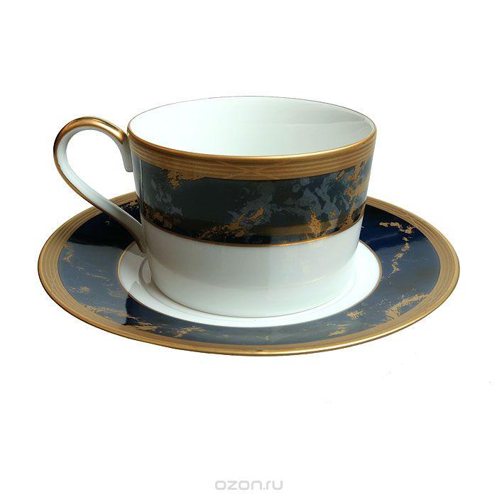 """Чайная пара Faberge Лазурный павильон, золотой, синий, белыйФА00002Диаметр чашки 8,5 см, высота 5,7 см. Диаметр блюдца 15,5 см.Сохранность хорошая. На донцах золотые клейма в виде герба Российской Империи, """"Faberge. Fint China"""", ниже черная марка """"Pavilion Lapis Lazuli"""". Предметы чайной пары, выполненные из белого фарфора, декорированы широким ободком - на сине-черном фоне золотые прожилки """"под мрамор"""". По краю чашки и блюдца находится тонкая золотая полоска."""