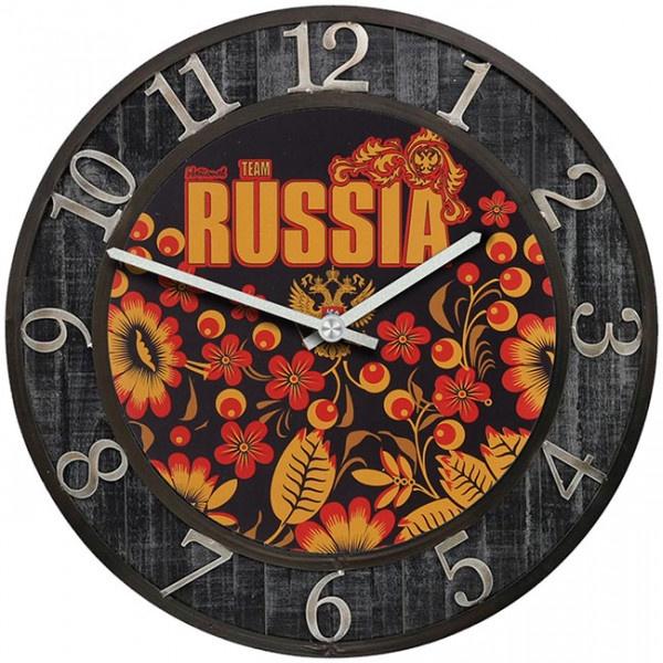 Настенные часы Kitch Clock 35013483501348Настенные часы с символикой. Механизм: Кварцевый; Корпус: Дерево; Размер: Диаметр 35 см;Рисунок: Russia