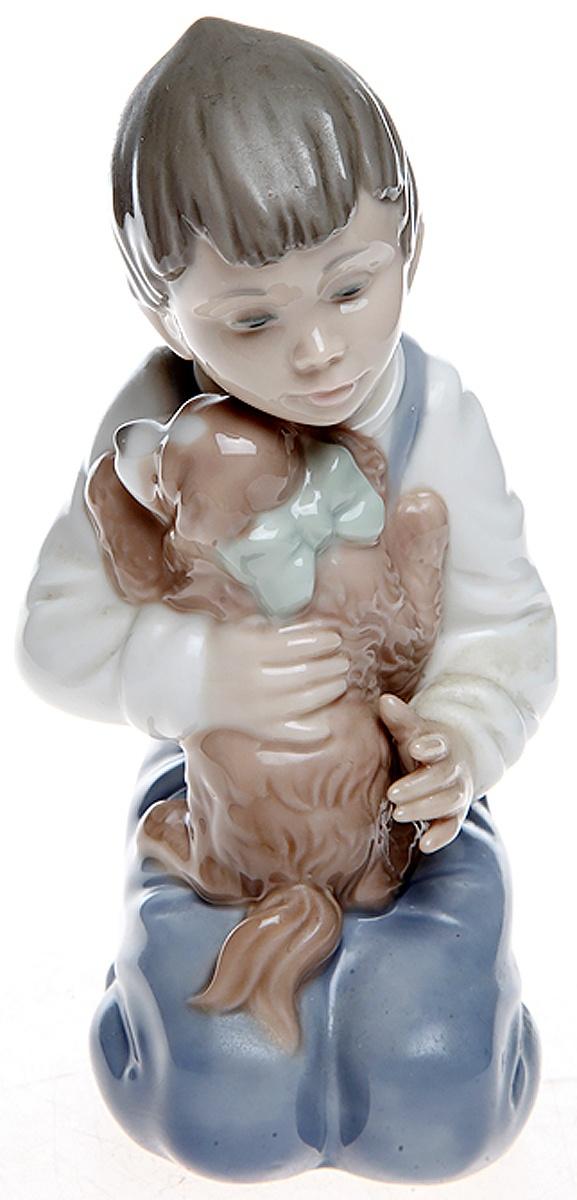 """Статуэтка Lladro """"Мальчик с собачкой"""". Фарфор, ручная роспись. Высота 15 см. Nao, Испания (Валенсия), 1990 год"""