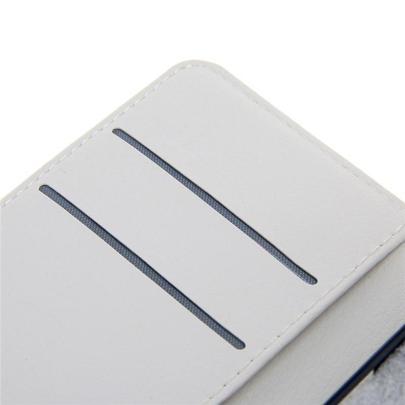 цена на Чехол флип подставка для ZTE Blade L110 / Blade A110 с магнитной застежкой, кармашками для карт с украшением в виде Эйфелевой башни со стразами