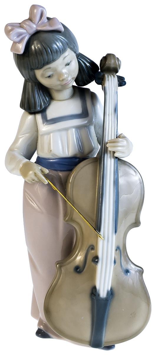 """Статуэтка """"Юная виолончелистка"""". Фарфор, ручная роспись. Высота 18,5 см. Nao для Lladro, Испания (Валенсия), 1987 год"""