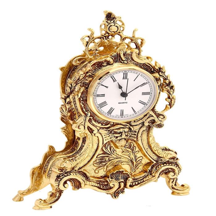 Часы настольные Екатерина, цвет: золотистый. 665730665730Изысканные настольные часы Екатерина с кварцевым механизмом выполнены из металла золотистого цвета в стиле ампир. Циферблат круглой формы оформлен римскими цифрами и имеет три стрелки - часовую, минутную и секундную. Часы - это не только функциональное устройство, но и оригинальный элемент декора, который впишется в любой интерьер. Благодаря стильному дизайну, качеству исполнения и практичности часы смогут стать великолепным подарком, который подчеркнет утонченный вкус своего обладателя.